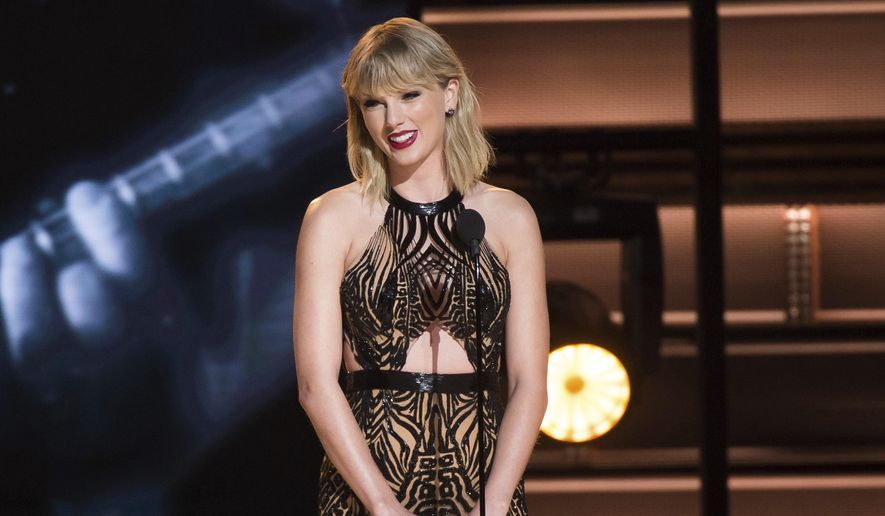 In this Nov. 2, 2016, file photo, Taylor Swift presents the award for entertainer of the year at the 50th annual CMA Awards in Nashville, Tenn. The trial of a lawsuit between Swift and David Mueller, a former radio host she accuses of groping her, began Monday, Aug. 7, 2017, in U.S. District Court in Denver. (Photo by Charles Sykes/Invision/AP, File)
