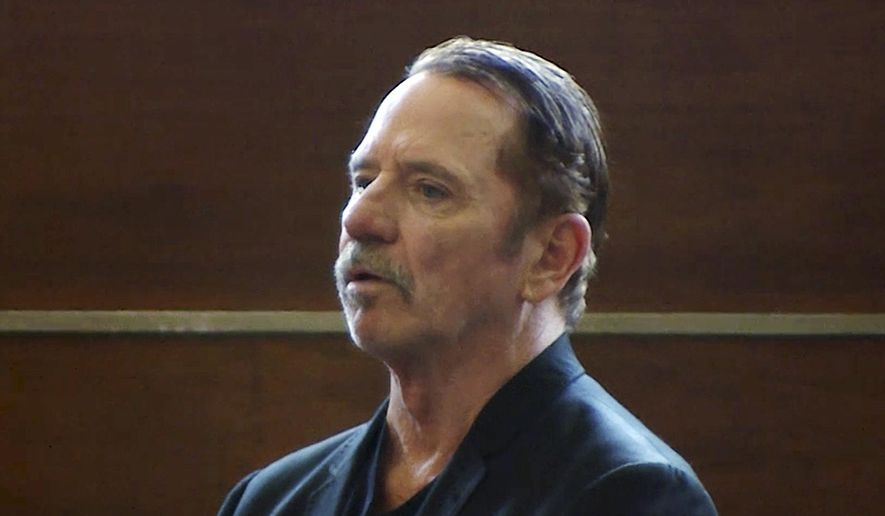 "In this still image from video, actor Tom Wopat stands during arraignment Thursday, Aug. 3, 2017, in Waltham, Mass., on indecent assault and battery and drug possession charges. Wopat who played Luke Duke on the 1980s television show ""The Dukes of Hazzard"" pleaded not guilty to the charges. Wopat, 65, was arrested on Wednesday night as he was leaving rehearsal for a performance of ""42nd Street."" (WCVB-TV via AP, Pool)"