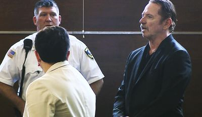 "In this still image taken from video, actor Tom Wopat, right, stands during arraignment Thursday, Aug. 3, 2017, in Waltham, Mass., on indecent assault and battery and drug possession charges. Wopat who played Luke Duke on the 1980s television show ""The Dukes of Hazzard"" pleaded not guilty to the charges. Wopat, 65, was arrested on Wednesday night as he was leaving rehearsal for a performance of ""42nd Street."" (WCVB-TV via AP, Pool)"