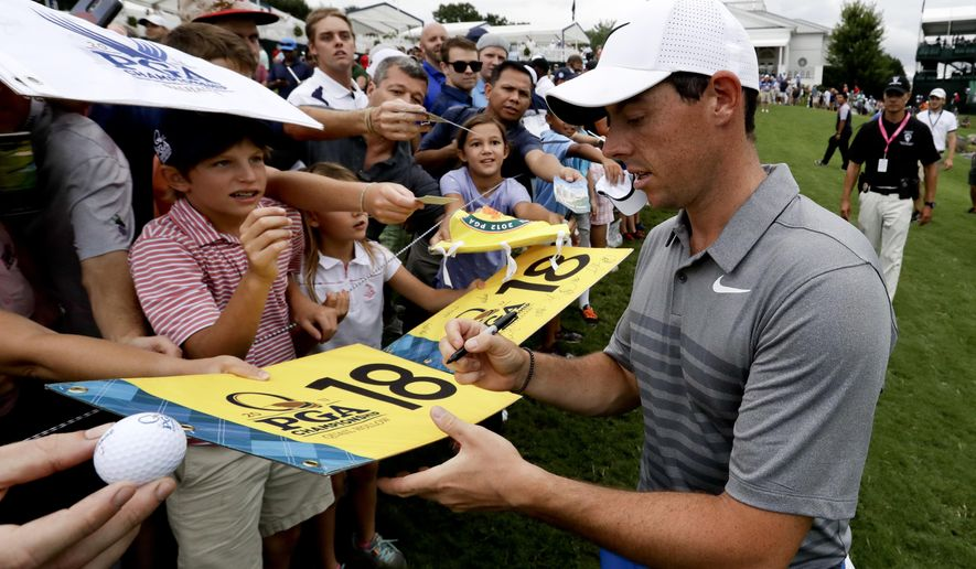 Rory McIlroy of Northern Ireland, sign autographs after a practice round at the PGA Championship golf tournament at the Quail Hollow Club Tuesday, Aug. 8, 2017, in Charlotte, N.C. (AP Photo/Chris Carlson)