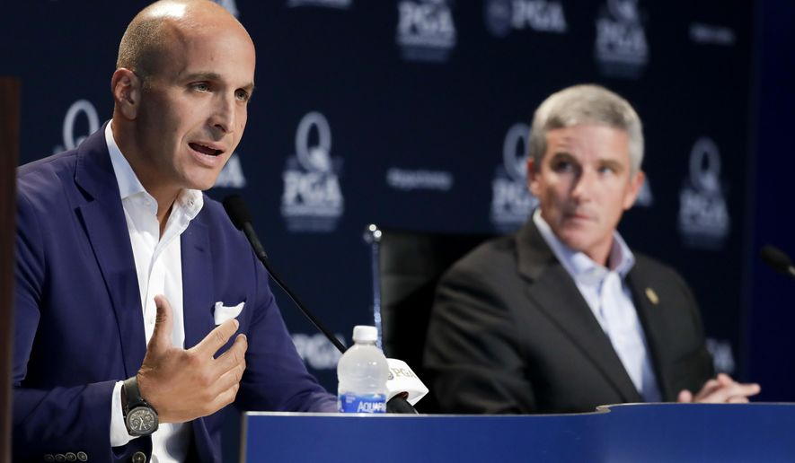 Peter Bevacqua, CEO of the PGA of America, talks during a news conference as PGA Tour commissioner Joy Monahan looks on at the PGA Championship golf tournament at the Quail Hollow Club Tuesday, Aug. 8, 2017, in Charlotte, N.C. (AP Photo/Chris Carlson)