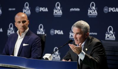 PGA Tour commissioner Jay Monahan speaks as Peter Bevacqua, CEO of the PGA of America, listens during a news conference at the PGA Championship golf tournament at the Quail Hollow Club Tuesday, Aug. 8, 2017, in Charlotte, N.C. (AP Photo/Chris Carlson)