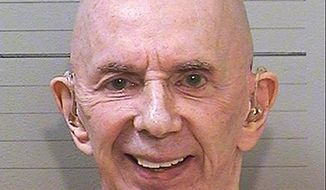 This June 14, 2017 mugshot provided by the California Department of Corrections and Rehabilitation shows rock 'n' roll music producer Phil Spector, completely free of the huge hair that was so striking during his murder trial. The 76-year-old music producer is smiling broadly and wearing hearing aids on both ears. He was convicted in 2009 of killing actress Lana Clarkson, and is serving a sentence of 19 years to life. (California Department of Corrections and Rehabilitation via AP)
