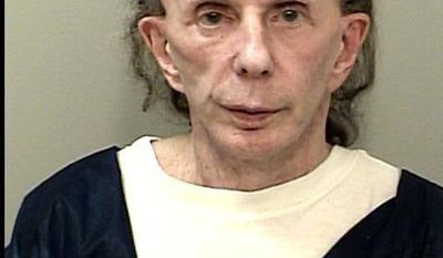 This Oct. 28, 2013 mugshot provided by the California Department of Corrections and Rehabilitation shows rock 'n' roll music producer Phil Spector, mostly bald with just a bit of hair, and completely free of the huge hair that was so striking during his murder trial. In a June 2017 mugshot the 76-year-old music producer is smiling broadly, completely bald and wearing hearing aids on both ears. He was convicted in 2009 of killing actress Lana Clarkson, and is serving a sentence of 19 years to life. (California Department of Corrections and Rehabilitation via AP)