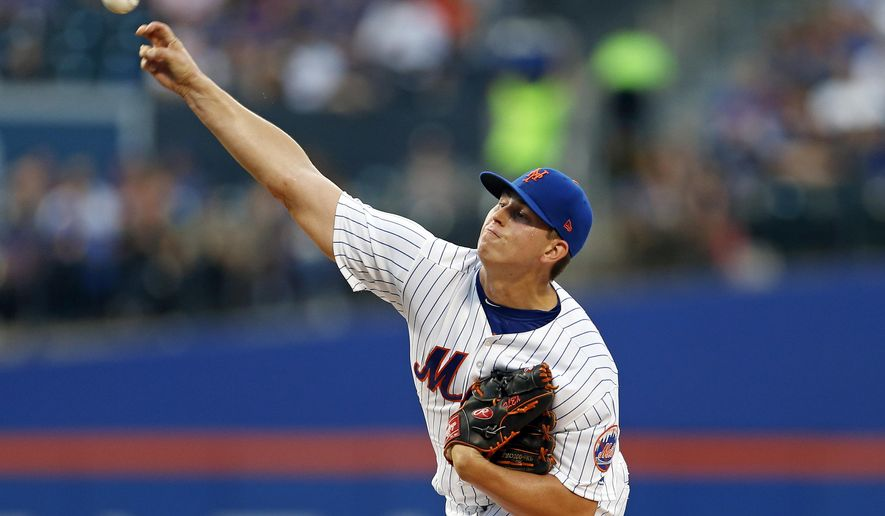 New York Mets pitcher Chris Flexen delivers a pitch during the first inning of an interleague baseball game against the Texas Rangers on Tuesday, Aug. 8, 2017, in New York. (AP Photo/Adam Hunger)