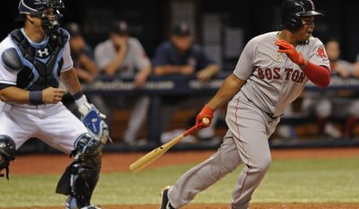 Tampa Bay Rays catcher Wilson Ramos, left, looks on as Boston Red Sox's Rafael Devers hits an infield grounder to score Dustin Pedroia from third base during the fourth inning of a baseball game Tuesday, Aug. 8, 2017, in St. Petersburg, Fla. (AP Photo/Steve Nesius)