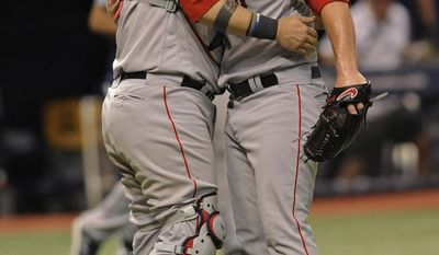 Boston Red Sox catcher Sandy Leon, left, and closer Craig Kimbrel celebrate a 2-0 win over the Tampa Bay Rays during a baseball game Tuesday, Aug. 8, 2017, in St. Petersburg, Fla. (AP Photo/Steve Nesius)