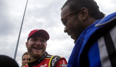 Dale Earnhardt Jr., and Washington Redskins Josh Norman share a laugh after driving around the track Tuesday Aug. 8, 2017 in Richmond, Va. (Shaban Athuman/Richmond Times-Dispatch via AP)