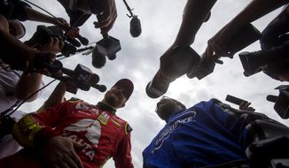 Dale Earnhardt Jr., and Washington Redskins Josh Norman talk to the media after Earnhardt Jr. drove Norman around the track,  Tuesday Aug. 8, 2017 in Richmond, Va. (Shaban Athuman/Richmond Times-Dispatch via AP)