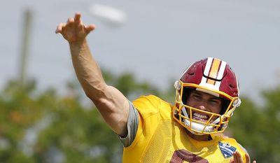 Washington Redskins' Kirk Cousins throws during NFL training camp, Thursday, Aug. 3, 2017 in Richmond, Va. (Mark Gormus/Richmond Times-Dispatch via AP)