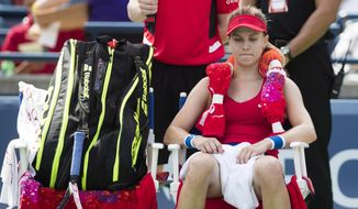 Eugenie Bouchard, of Canada, sits in her chair between games against Donna Vekic, of Croatia, during their first-round match at the Rogers Cup WTA women's tennis tournament in Toronto, Tuesday, Aug. 8, 2017. (Mark Blinch/The Canadian Press via AP)