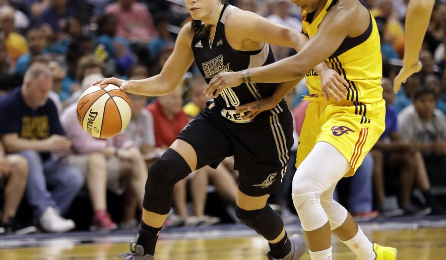 FILE - In this July 12, 2017, file photo, San Antonio Stars' Kelsey Plum, left, goes toward the basket against Indiana Fever's Briann January during the first half of a WNBA basketball game in Indianapolis. Plum has been playing a lot better lately and so have the Stars. (AP Photo/Darron Cummings, File)