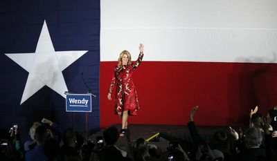 FILE - In this Nov. 4, 2014, file photo, Texas Democratic gubernatorial candidate Wendy Davis waves to supporters as she arrives to make her concession speech at her election watch party in Fort Worth, Texas. Four years ago the Democrats pumped big money and organizing muscle into Texas, hoping a gubernatorial candidate that generated national stardom with a 12-hour filibuster could begin turning America's largest red state blue. But Wendy Davis lost by 20-plus points and, with the 2018 governor's race looming, her party has no major candidate to run this time _ meaning it may only be able to hope to do that well again. That symbolizes just how far a promised Texas Democratic resurgence has fallen. (AP Photo/Tony Gutierrez, File)