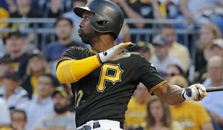 Pittsburgh Pirates' Andrew McCutchen watches his solo home run off Detroit Tigers starting pitcher Matthew Boyd in the fourth inning of a baseball game in Pittsburgh, Tuesday, Aug. 8, 2017. (AP Photo/Gene J. Puskar)