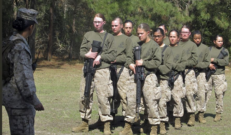 In this Feb. 21, 2013, file photo, female recruits stand at the Marine Corps Training Depot on Parris Island, S.C. The U.S. Marine Corps for the first time is eyeing a plan to let women attend what has been male-only combat training in Southern California, as officials work to quash recurring problems with sexism and other bad behavior among Marines, according to Marine Corps officials. (AP Photo/Bruce Smith, File)