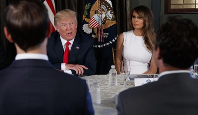 First lady Melania Trump listens as President Donald Trump speaks during a briefing on the opioid crisis, Tuesday, Aug. 8, 2017, at Trump National Golf Club in Bedminster, N.J. (AP Photo/Evan Vucci)
