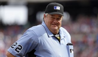 FILE - In this Saturday, June 17, 2017 file photo, Crew chief Joe West smiles as he talks to staff in the Seattle Mariners dugout in the fourth inning of a baseball game against the Texas Rangers in Arlington, Texas. Joe West, the major leagues' senior umpire, has been suspended for three days for comments he made about Texas third baseman Adrian Beltre, Tuesday, Aug. 8, 2017. (AP Photo/Tony Gutierrez, File)