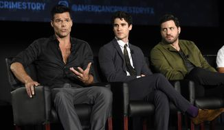 "Ricky Martin, left, a cast member in the FX series ""The Assassination of Gianni Versace: American Crime Story,"" answers a reporter's question as fellow cast members Darren Criss, center, and Edgar Martinez look on during the 2017 Television Critics Association Summer Press Tour at 20th Century Fox Studios on Wednesday, Aug. 9, 2017, in Los Angeles. (Photo by Chris Pizzello/Invision/AP)"