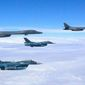 "Two U.S. Air Force B-1B Lancers joined up with Japanese and South Korean fighter jets for a 10-hour ""solidarity"" mission over Japan on Monday. The Pacific Air Forces Twitter account is using #ironclad. (U.S. Air Force)"