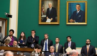Congressional staffers attended a House Energy and Commerce Committee hearing in 2013. Some staffers dismiss claims in the Congressional Management Foundation report. They say lazy cohorts don't make use of Congress' extraordinary resources and instead outsource research and decision-making to lobbyists. (Associated Press/File)