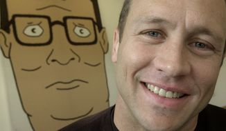 "Mike Judge, co-creator of the Fox cartoon series ""King of the Hill,"" poses in front of an illustration of Hank Hill,  the animated character he voices, in Los Angeles on Oct. 28, 2002. (Associated Press) **FILE**"