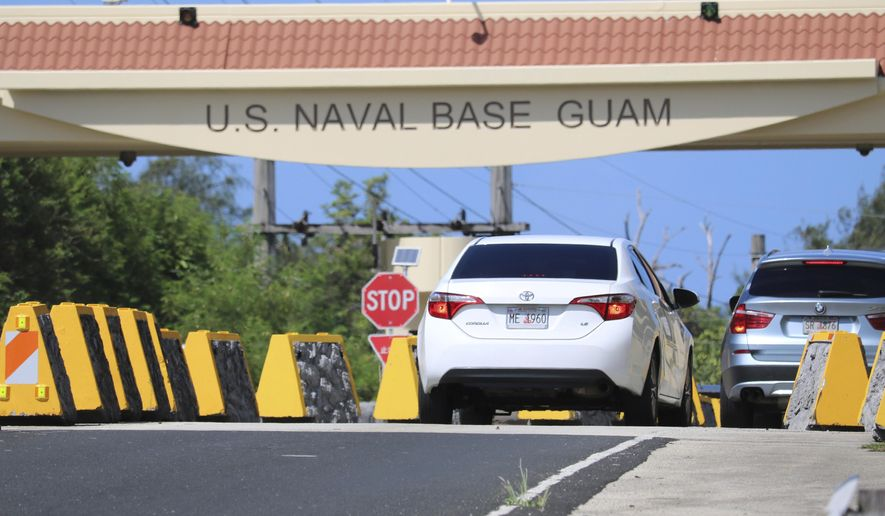 In this May 11, 2017, file photo, cars enter Naval Base Guam near Hagatna, Guam. Security and defense officials on Guam said on Aug. 9, 2017, that there is no imminent threat to people there or in the Northern Mariana Islands after North Korea said it was examining its operational plans for attack. (AP Photo/Haven Daley, File)