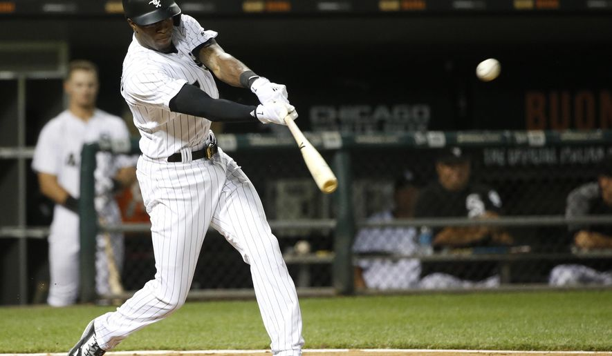 Chicago White Sox's Tim Anderson hits an RBI double off Houston Astros starting pitcher Collin McHugh during the sixth inning of a baseball game Wednesday, Aug. 9, 2017, in Chicago. (AP Photo/Charles Rex Arbogast)