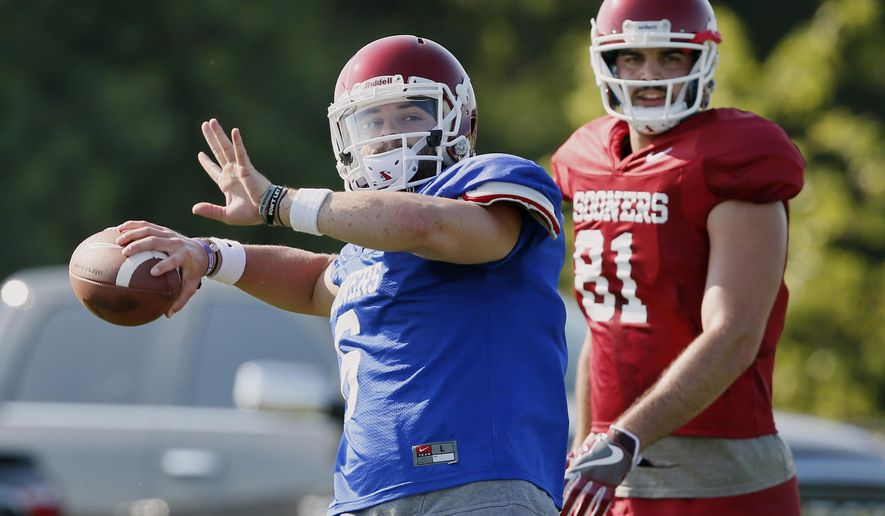 FILE In this Aug. 3, 2017, file photo, Oklahoma quarterback Baker Mayfield, left, throws in front of tight end Mark Andrews (81) during an NCAA college football practice in Norman, Okla. Oklahoma, with Heisman Trophy finalist quarterback Mayfield back for his senior season, will be going for its third consecutive Big 12 title, and 11th overall. (AP Photo/Sue Ogrocki, File)
