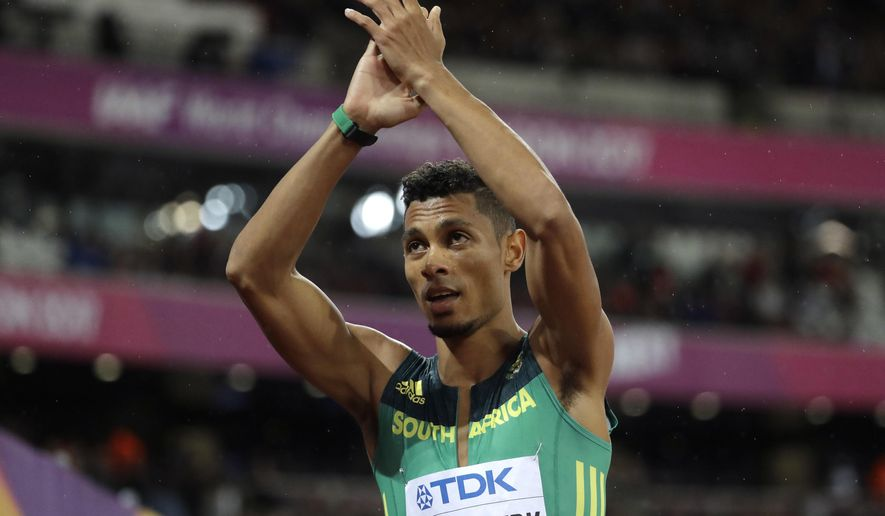 South Africa's Wayde van Niekerk applauds after finishing a Men's 200m semifinal during the World Athletics Championships in London Wednesday, Aug. 9, 2017. (AP Photo/David J. Phillip)