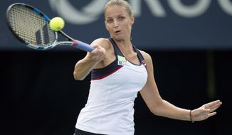 Karolina Pliskova, of the Czech Republic, hits a return to Anastasia Pavlyuchenkova, of Russia, during the Rogers Cup women's tennis tournament in Toronto, Wednesday, Aug. 9, 2017. (Frank Gunn/The Canadian Press via AP)