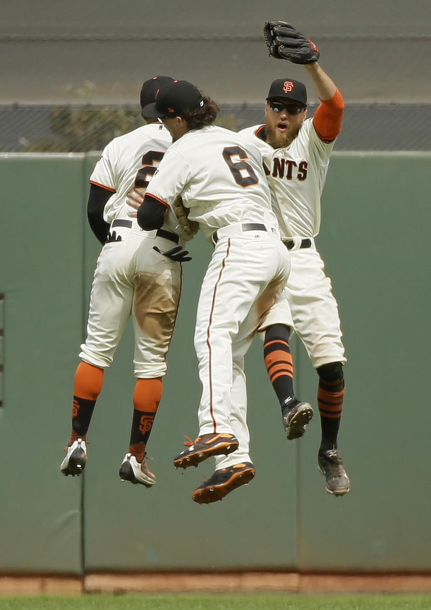 San Francisco Giants outfielders from left, Denard Span, Jarrett Parker, and Hunter Pence celebrate at the end of a baseball game against the Chicago Cubs Wednesday, Aug. 9, 2017, in San Francisco. San Francisco won the game 3-1. (AP Photo/Eric Risberg)