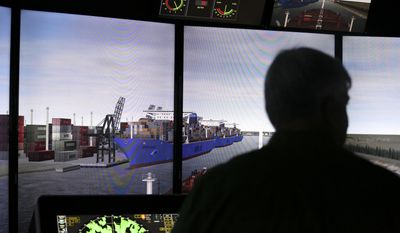 FOR USE SUNDAY AUG. 13, 2017, OR THEREAFTER-Captain Thomas Goodwin monitors the ship consoles as the large oil tanker is entering a narrow part of the channel during a training simulator exercise at San Jacinto College Maritime Wednesday, Aug. 2, 2017, in La Porte. The simulators are used to prepare for larger ships that are expected to call on the Port of Houston. ( Yi-Chin Lee /Houston Chronicle via AP)