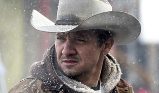"""This image released by The Weinstein Company shows Jeremy Renner in a scene from """"Wind River."""" (Fred Hayes/The Weinstein Company via AP)"""