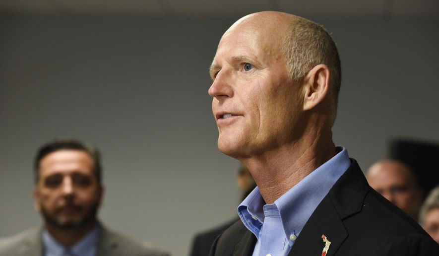 Florida Gov. Rick Scott speaks to reporters during a news conference in Tampa in this Tuesday, Aug. 8, 2017 photo.  (Chris Urso/Tampa Bay Times via AP) **FILE**