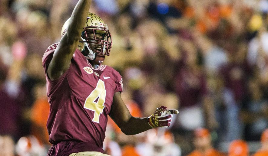 FILE - In this Oct. 29, 2016, file photo, Florida State's Tarvarus McFadden celebrates his interception against Clemson during the second half of an NCAA college football game in Tallahassee, Fla. McFadden expects to continue to be tested by opposing offenses despite tying for the national lead in interceptions last season. (AP Photo/Mark Wallheiser, File)