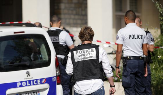 French police officers work on the scene where French soldiers were hit and injured by a vehicle in the western Paris suburb of Levallois-Perret near Paris, France, Wednesday, Aug. 9, 2017. French police are searching for a driver who slammed his BMW into a group of soldiers, injuring six of them in an apparent ambush before speeding away, officials said. The incident in Levallois, northwest of Paris, is the latest of several attacks targeting security forces in France.(AP Photo/Kamil Zihnioglu)