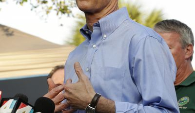 FILE- In this June 13, 2016, file photo, Florida Gov. Rick Scott speaks about details of the fatal shootings at Pulse Orlando nightclub during a media briefing in Orlando, Fla. Gay rights advocates said Scott's office broke a promise made after the shooting in Florida that he would sign an order prohibiting discrimination against LGBTQ state workers and contractors. (AP Photo/Chris O'Meara, File)