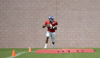 New York Giants quarterback Geno Smith runs a drill during NFL football training camp, Tuesday, Aug. 8, 2017, in East Rutherford, N.J. (AP Photo/Julio Cortez)