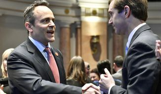 FILE - In this Feb. 8, 2017, file photo, Kentucky Gov. Matt Bevin, left, shakes hands with Kentucky Attorney General Andy Beshear before the governor's State of the Commonwealth address in Frankfort, Ky. Beshear has sued Bevin four times since both men took office. Lawyers for the two politicians are scheduled to meet in court twice over the next 10 days. (AP Photo/Timothy D. Easley, File)