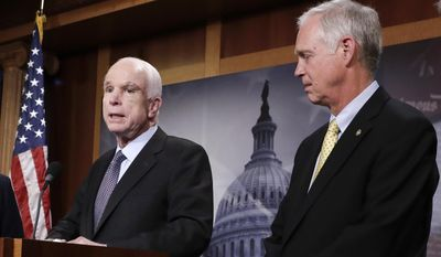 In this July 27, 2017 file photo, Sen. Ron Johnson, R-Wis. listens as Sen. John McCain, R-Ariz. speaks on Capitol Hill in Washington.  Johnson suggested that John McCain's brain tumor and the after-midnight timing of the vote were factors in the Arizona lawmaker's decisive vote against the GOP health care bill. In a radio interview, Johnson answered questions about the collapse of the years-long Republican effort to repeal and replace Barack Obama's Affordable Care Act, his criticism of the process and McCain's dramatic vote.  (AP Photo/J. Scott Applewhite)