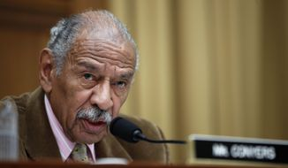 FILE - In this April 4, 2017 file photo, Rep. John Conyers, D-Mich. speaks on Capitol Hill in Washington, April 4, 2017. The House Ethics committee says it is continuing an investigation of Conyers, the longest-serving member of Congress and the top Democrat on the Judiciary Committee.  (AP Photo/Alex Brandon, File)