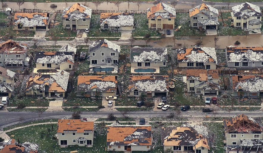 FILE - In this Aug. 25, 1992, file photo, rows of damaged houses sit between Homestead and Florida City, Fla. Almost 25 years after Hurricane Andrew struck south of Miami, a new insurance underwriters' analysis says the city's vulnerability to another Category 5 hurricane has grown exponentially. (AP Photo/Mark Foley, File)