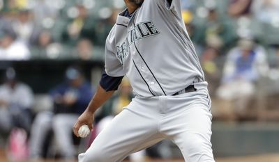 Seattle Mariners starting pitcher Yovani Gallardo throws to the Oakland Athletics during the first inning of a baseball game Wednesday, Aug. 9, 2017, in Oakland, Calif. (AP Photo/Marcio Jose Sanchez)