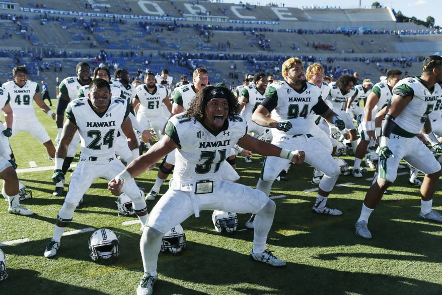 FILE - In this Oct. 22, 2016, file photo, Hawaii linebacker Jahlani Tavai leads his teammates in the team's traditional haka, or war cry, after defeating Air Force 34-27 in double overtime in an NCAA college football game at Air Force Academy, Colo. (AP Photo/David Zalubowski, File)