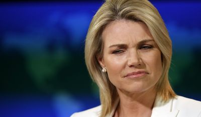 """State Department spokeswoman Heather Nauert listens to a question during a briefing at the State Department in Washington, Wednesday, Aug. 9, 2017. The State Department says President Donald Trump is """"on the same page"""" with the rest of U.S. government with his fiery threat to North Korea. Nauert said the White House, State Department and Pentagon are all in agreement. She says the world, too, is speaking with once voice.  (AP Photo/Alex Brandon)"""