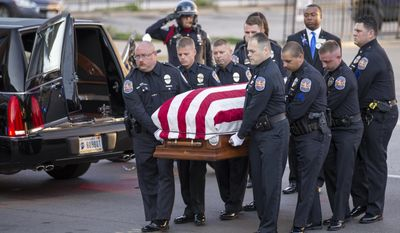 Pallbearers carrying the body of Southport Police Lt. Aaron Allan, arrives at Bankers Life Fieldhouse in advance of a funeral service and procession, Saturday, Aug. 5, 2017 in Indianapolis. Allan, a police officer who authorities say was killed by a man he was trying to rescue from an overturned car in Indianapolis was hailed during his funeral for his community dedication. (Robert Scheer/The Indianapolis Star via AP)