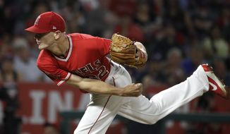 Los Angeles Angels starting pitcher Parker Bridwell throws against the Baltimore Orioles during the fourth inning of a baseball game, Tuesday, Aug. 8, 2017, in Anaheim, Calif. (AP Photo/Jae C. Hong)