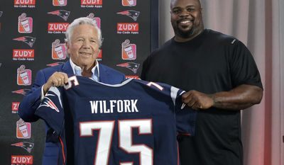 New England Patriots owner Robert Kraft, left, and former New England Patriots' Vince Wilfork, right, display a jersey during a news conference at Gillette Stadium, Wednesday, Aug. 9, 2017, in Foxborough, Mass., where Wilfork announced his retirement from NFL football. Wilfork signed a contract during the news conference to make him a Patriots life member. (AP Photo/Steven Senne)