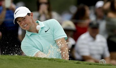 Rory McIlroy of Northern Ireland, hits from the bunker on the ninth hole during a practice round at the PGA Championship golf tournament at the Quail Hollow Club Wednesday, Aug. 9, 2017, in Charlotte, N.C. (AP Photo/Chris Carlson)