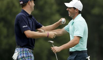 Rory McIlroy of Northern Ireland, right, and Justin Thomas share a laugh ninth hole during a practice round at the PGA Championship golf tournament at the Quail Hollow Club Wednesday, Aug. 9, 2017, in Charlotte, N.C. (AP Photo/Chris Carlson)